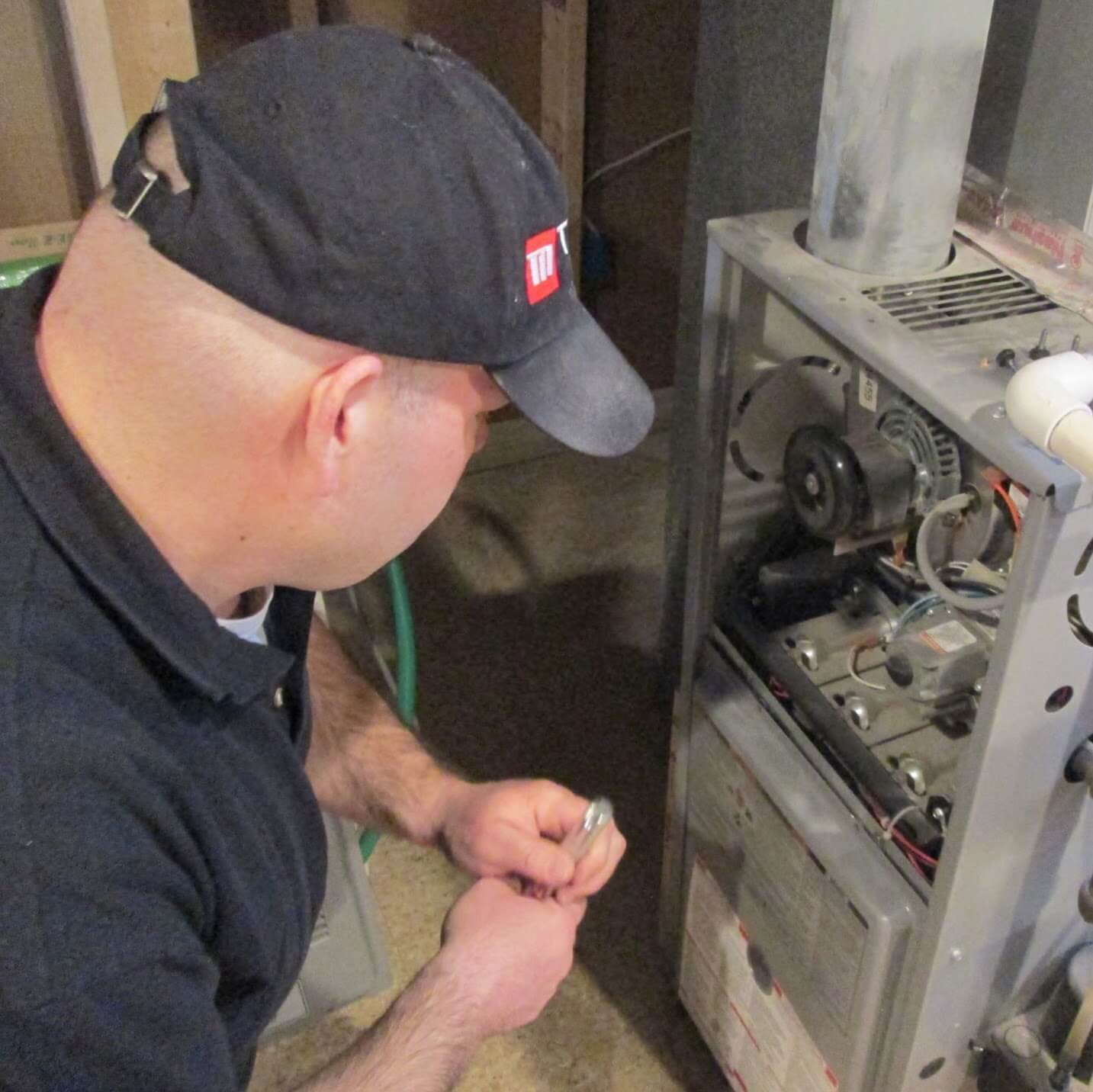 Home Inspector looking at a furnace